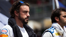 Alonso upbeat after happy Ferrari moves on