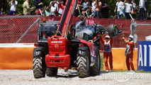 Mercedes AMG F1 W07 Hybrid of race retiree Nico Rosberg is craned away from the gravel trap