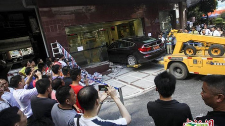 BMW 535i GT crashes into bank's VIP area in China