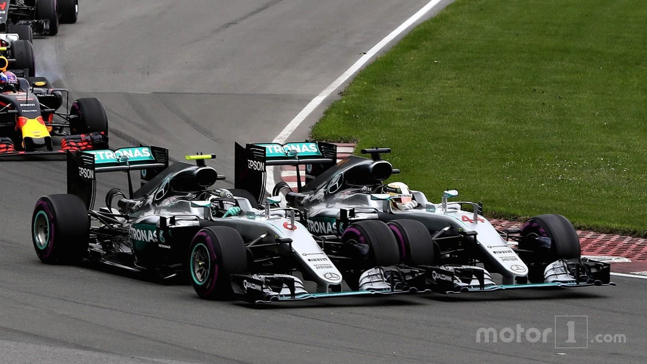 Lewis Hamilton and Nico Rosberg make contact in Turn 1