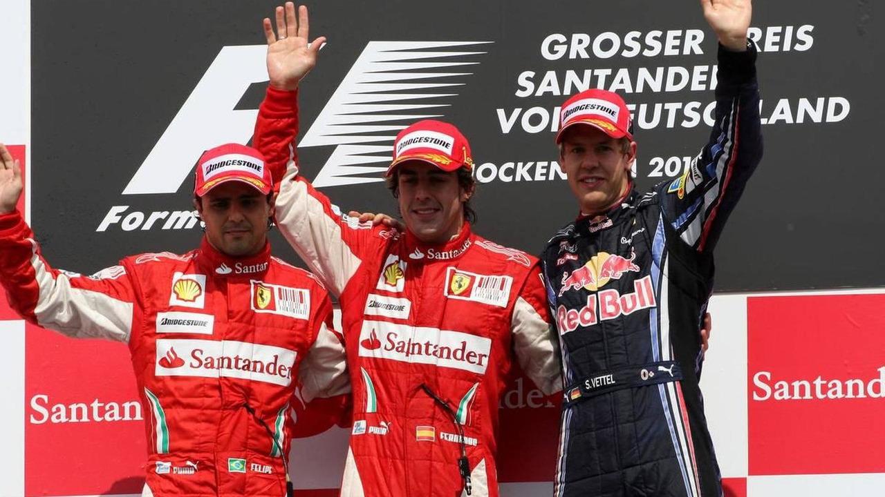elipe Massa (BRA), Scuderia Ferrari, Fernando Alonso (ESP), Scuderia Ferrari and Sebastian Vettel (GER), Red Bull Racing - Formula 1 World Championship, Rd 11, German Grand Prix, Sunday Podium