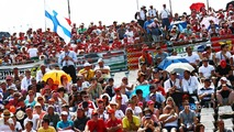 Finnish flag and fans in the grandstand