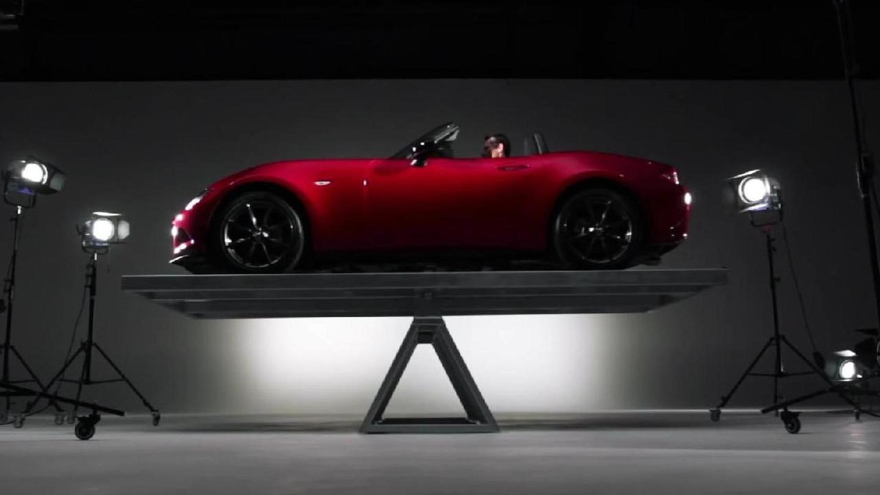Mazda MX-5 on a fulcrum balance structure