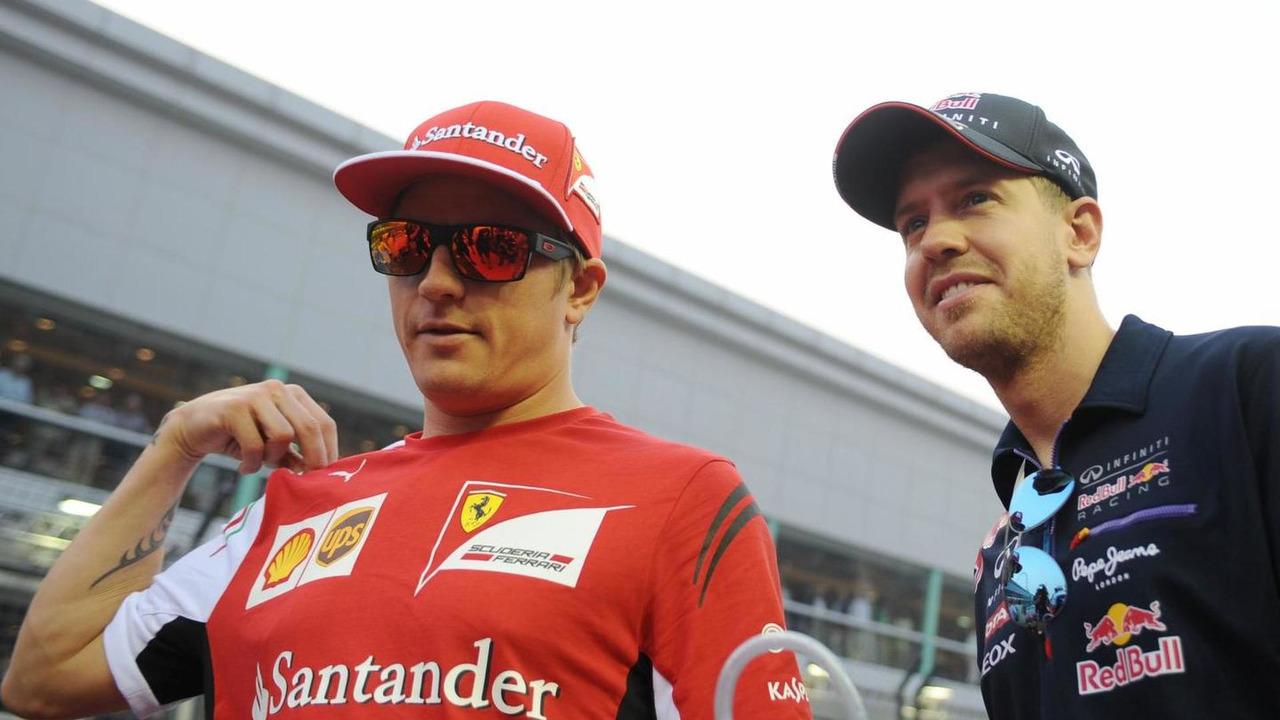 Kimi Raikkonen (FIN) with Sebastian Vettel (GER) / XPB