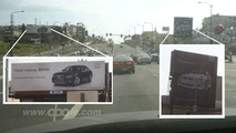 Feuding BMW and Audi billboards on Santa Monica Blvd