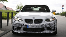 BMW M2 spied up close partially hiding production body