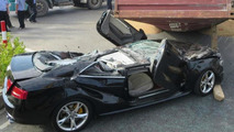 Audi S5 flattened by container
