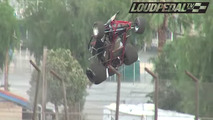 Driver walks away after flying over track's 22-foot fence