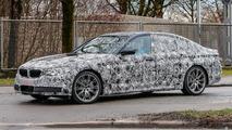 Latest BMW 5 Series spy photos show unusual exhaust tips