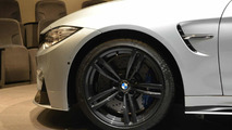 BMW M4 Coupe showcased with carbon fiber rear wing