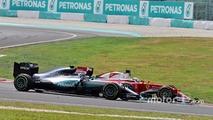 Nico Rosberg, Mercedes AMG F1 W07 Hybrid and Sebastian Vettel, Ferrari SF16-H at the start of the race following their collision