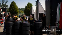 Pirelli staff unpack tyres in the paddock
