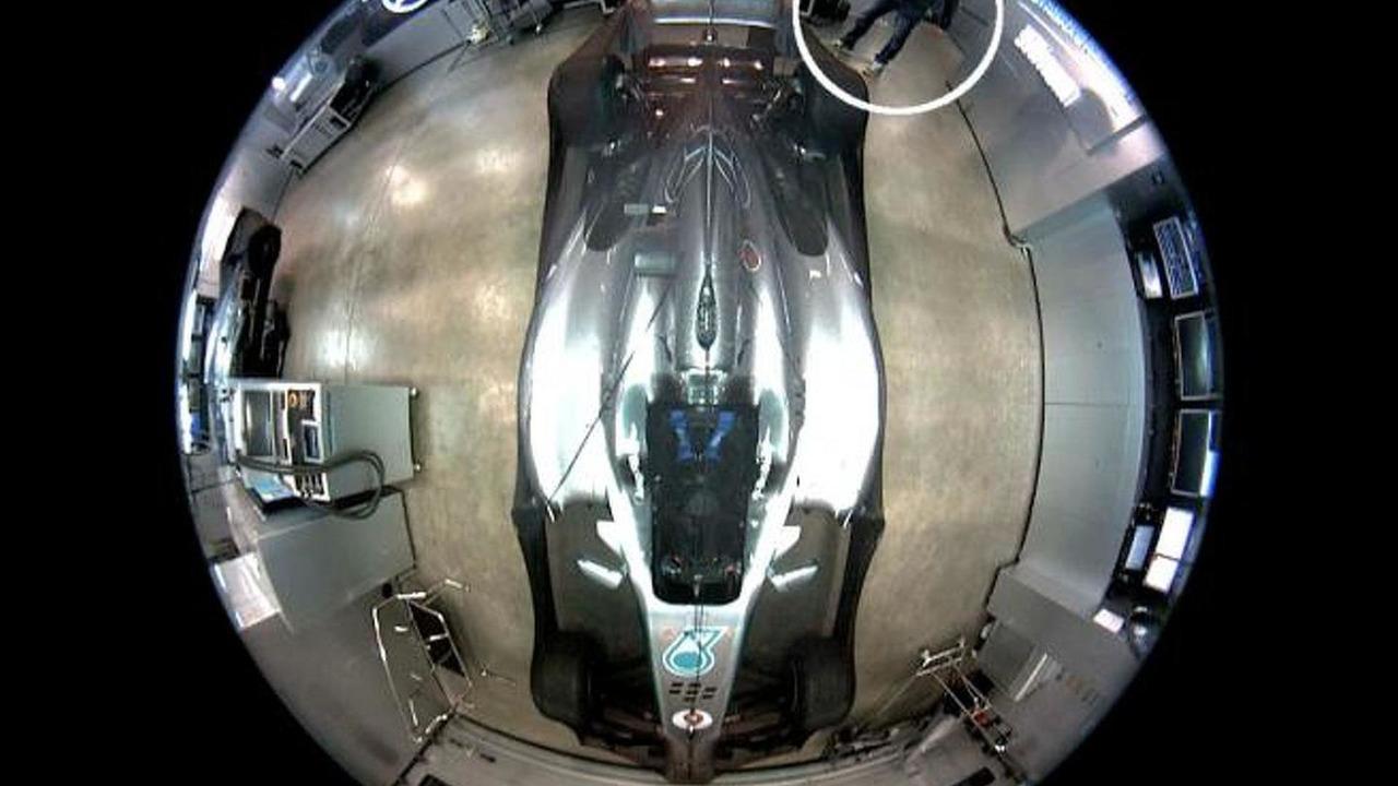 Nico Rosberg 2013 Schubeth helmet theft screenshot from FIA security camera in parc ferme 07.07.2013