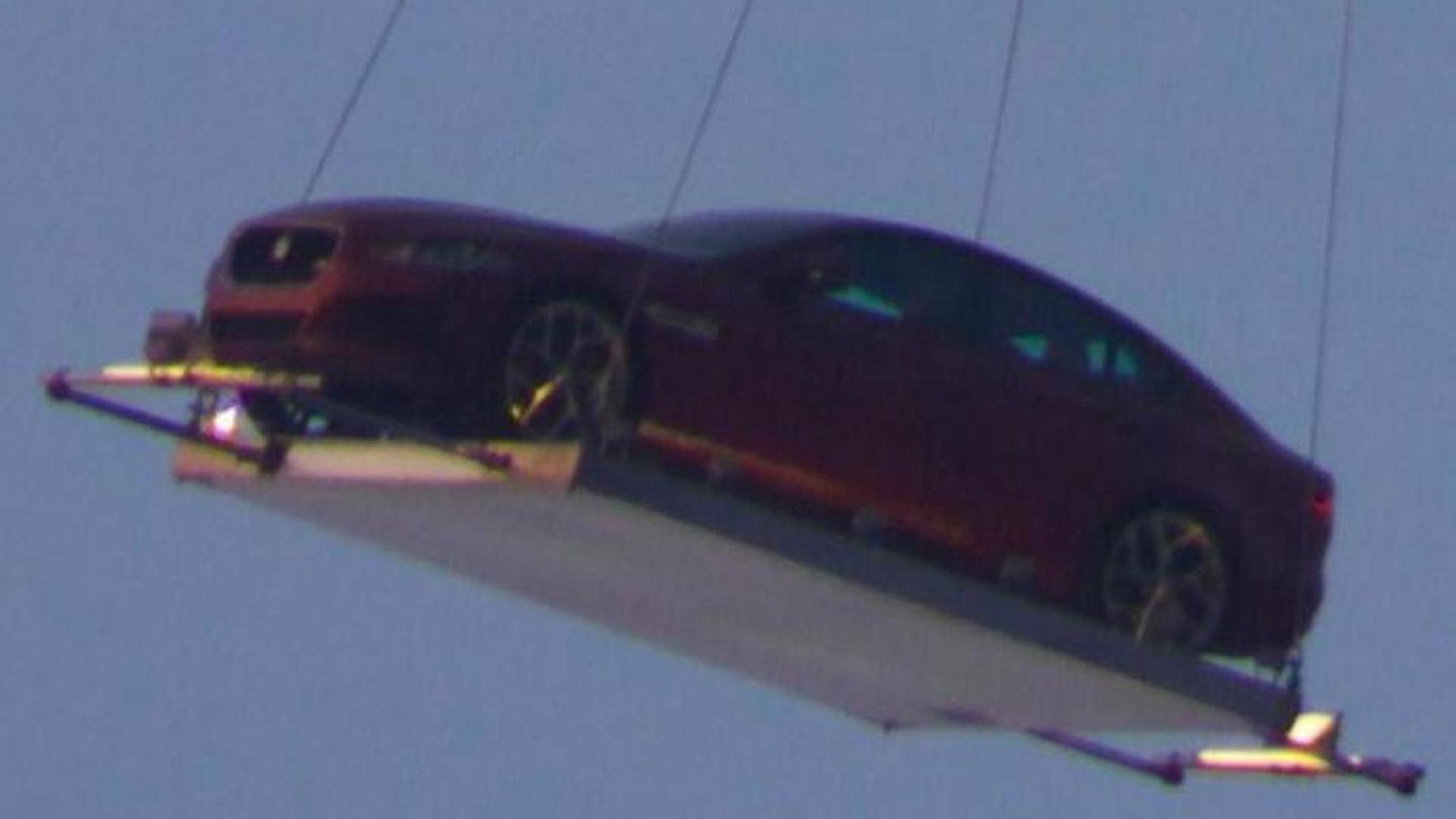 Jaguar XE photographed flying over London for premiere