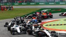Sergio Perez, Sahara Force India F1 VJM09, Felipe Massa, Williams FW38, and Nico Hulkenberg, Sahara Force India F1 VJM09 at the start of the race