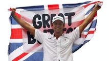 Button celebrated title alone in hotel