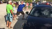 Bystander breaks window to free dog in hot car