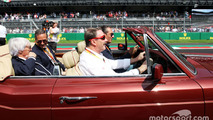 Nigel Mansell, drives Carlos Slim Domit, Chairman of America Movil and Bernie Ecclestone, on the drivers parade
