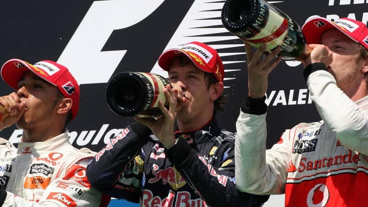 Lewis Hamilton (GBR), McLaren Mercedes with 1st place Sebastian Vettel (GER), Red Bull Racing and 3rd place Jenson Button (GBR), McLaren Mercedes, European Grand Prix, Sunday Podium, 27.06.2010 Valencia, Spain