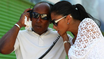Anthony Hamilton (GBR), Father of Lewis Hamilton and Nicole Scherzinger (USA), Singer in the Pussycat Dolls and girlfriend of Lewis Hamilton listen in to Lewis on the radio (GBR), European Grand Prix, 22.08.2009 Valencia, Spain