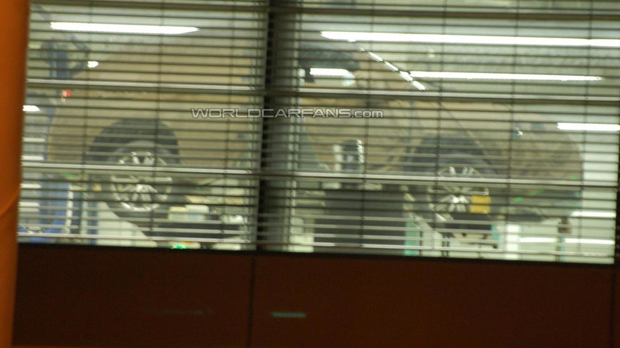Audi Q3 caught for first time through factory window