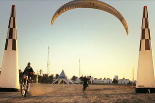 An Extreme Ride with a Motorcyle and a Parachute