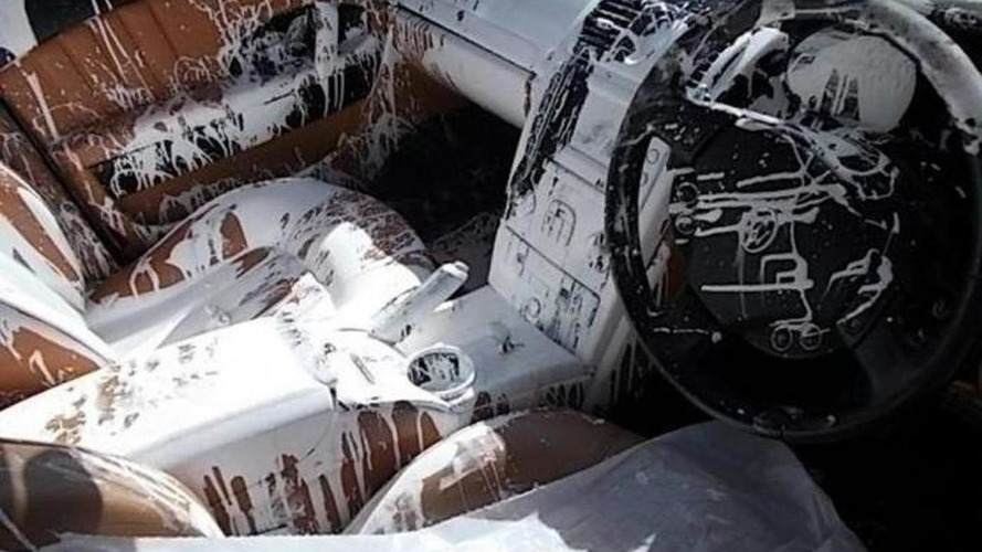 A Maserati gets written off after being covered in white paint
