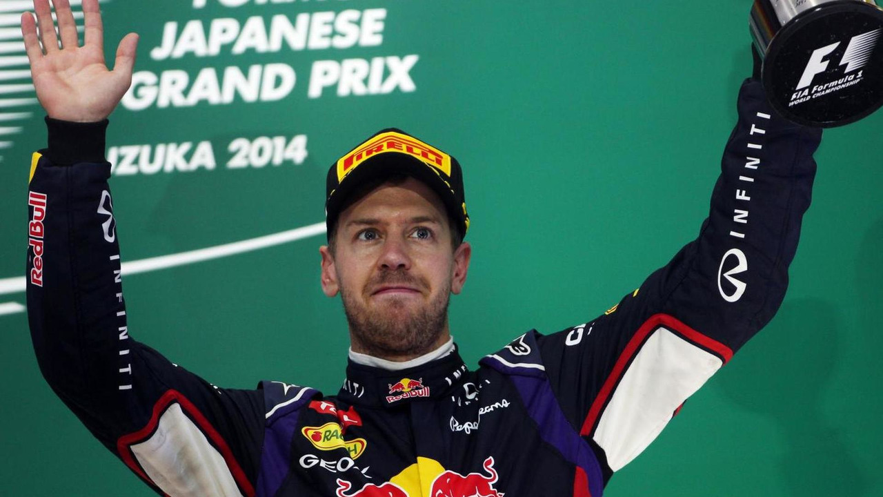Sebastian Vettel (GER) celebrates his third position on the podium, 05.10.2014, Japanese Grand Prix, Suzuka / XPB