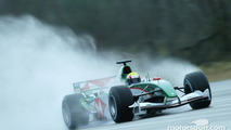 Mark Webber tests the new Jaguar R5 at Ford's Proving Ground in Lommel, Belgium