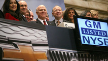 General Motors CEO Dan Akerson (center) rings the opening bell (horn) at the New York Stock Exchange, marking a historic milestone as GM's common stock begins trading publicly again Thursday, November 18, 2010 in New York. GM and NYSE executives surround