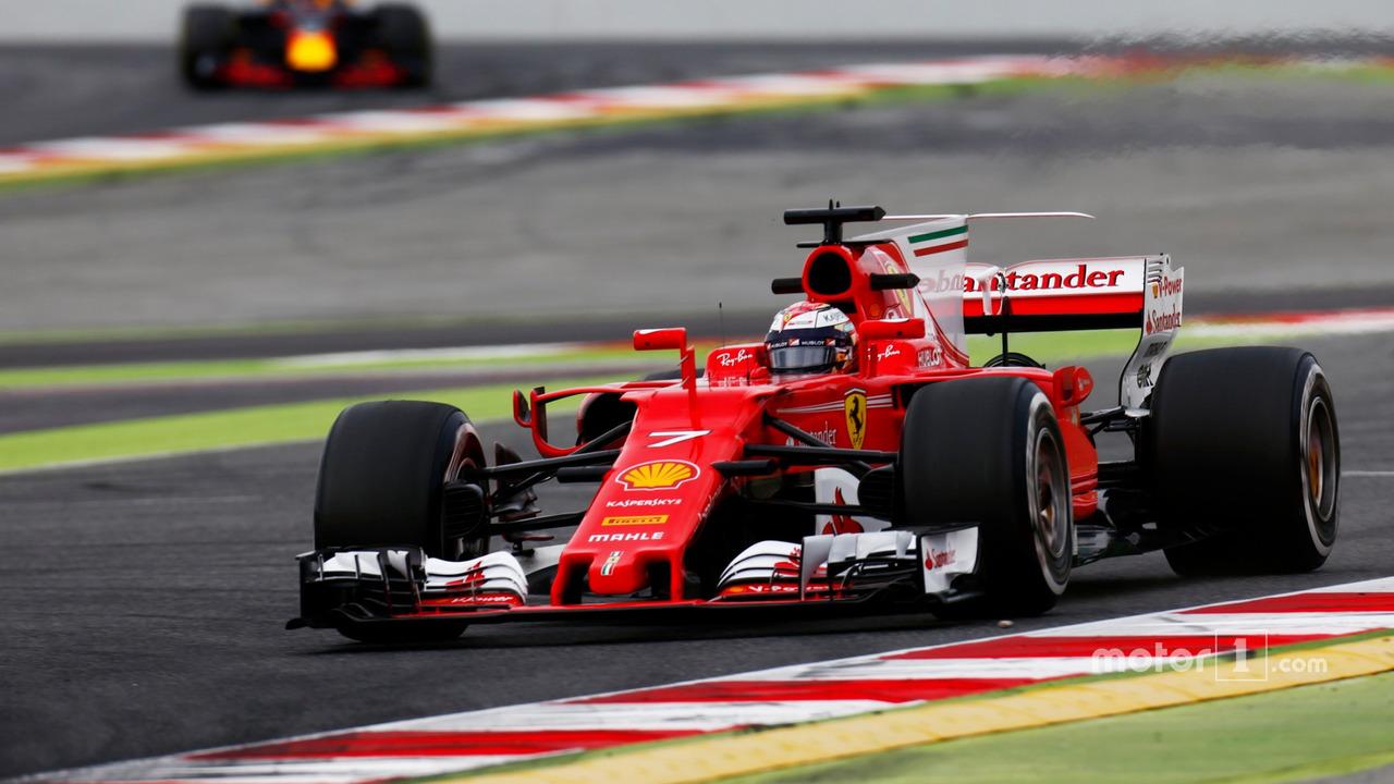 Kimi Raikkonen, Ferrari, leads Max Verstappen, Red Bull Racing RB13