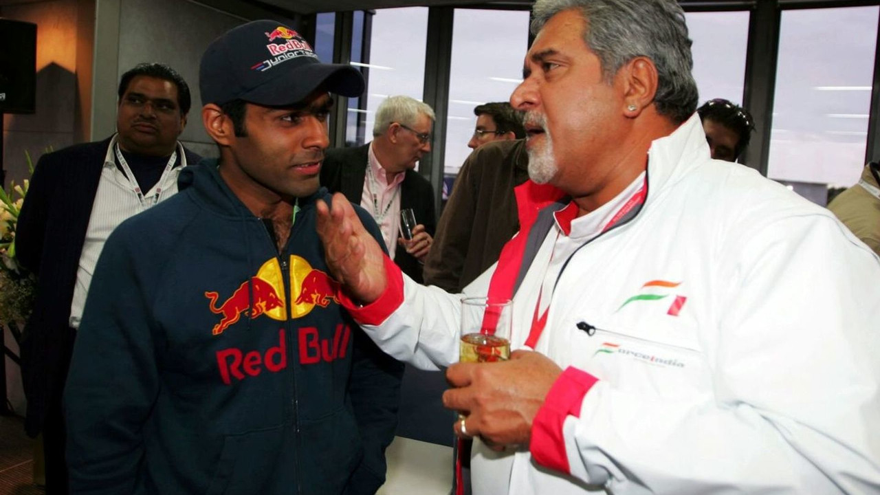 Karun Chandhok (IND) iSport International and Dr. Vijay Mallya (IND) Force India F1 Team Owner at a Force India F1 Team cocktails party.