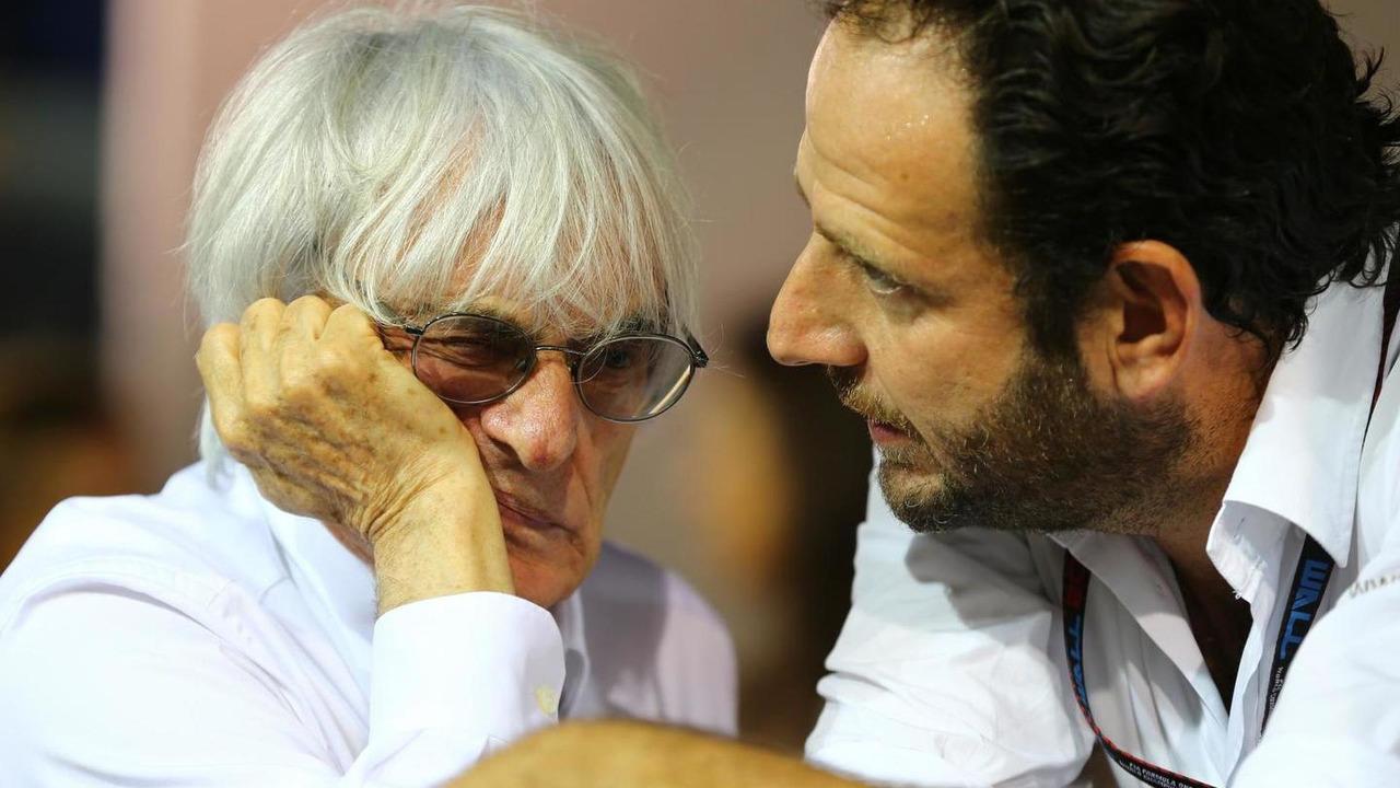 Bernie Ecclestone with Matteo Bonciani FIA Media Delegate 22.09.2013 Singapore Grand Prix
