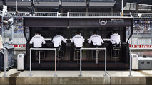 The Mercedes team on the pit wall