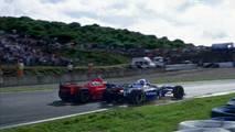 Michael Schumacher, Ferrari F310B y Jacques Villeneuve, Williams FW19 Renault en la Curva Dry Sack