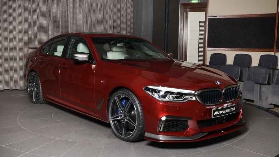 BMW M550i xDrive Aventurine Red with AC Schnitzer body kit