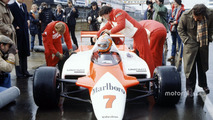 John Watson, McLaren MP4-1-Cosworth with Ron Dennis in the pitlane
