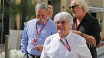 Bernie Ecclestone, with Chase Carey, Formula One Group Chairman and Flavio Briatore