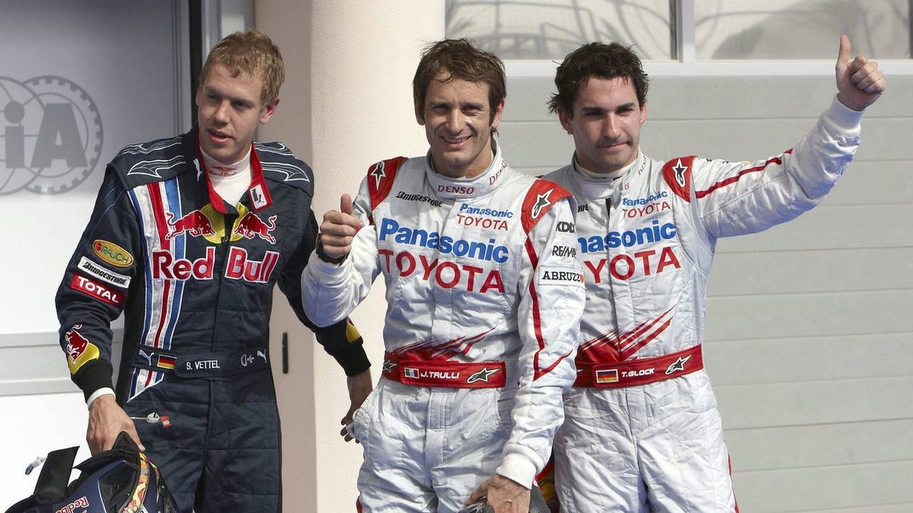 Sebastian Vettel, Jarno Trulli and Timo Glock celebrate after qualifying in Bahrain 2009.