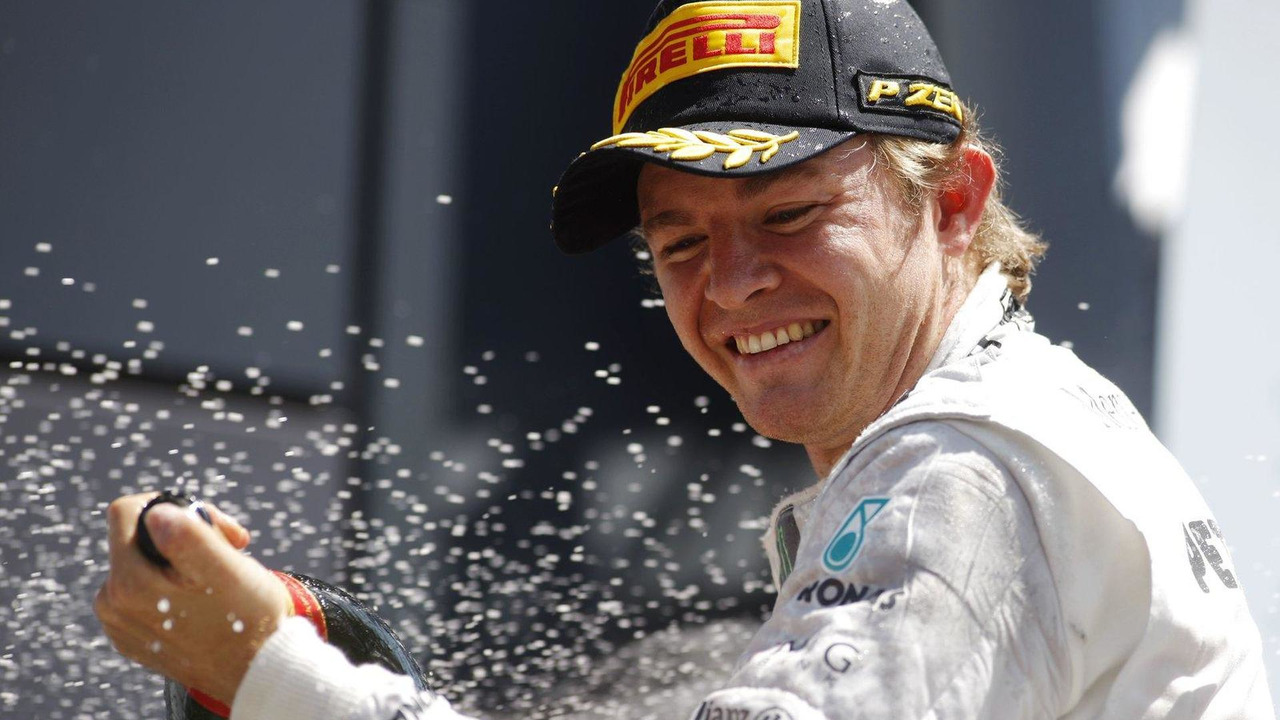 Race winner Nico Rosberg on the podium, British Grand Prix, 30.06.2013