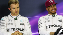 Nico Rosberg and team mate Lewis Hamilton in the post qualifying FIA Press Conference