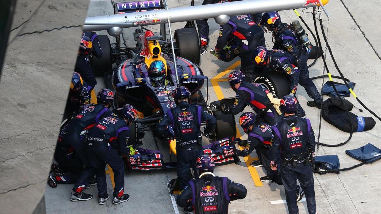 Sebastian Vettel (GER) in Red Bull Racing RB10 pit stop, 30.03.2014, Malaysian Grand Prix, Sepang / XPB