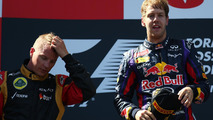 2nd place Kimi Raikkonen (FIN) Lotus F1 Team with 1st place Sebastian Vettel (GER) Red Bull Racing