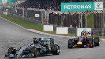 Nico Rosberg (GER) and Sebastian Vettel (GER), 30.03.2014, Malaysian Grand Prix, Sepang / XPB