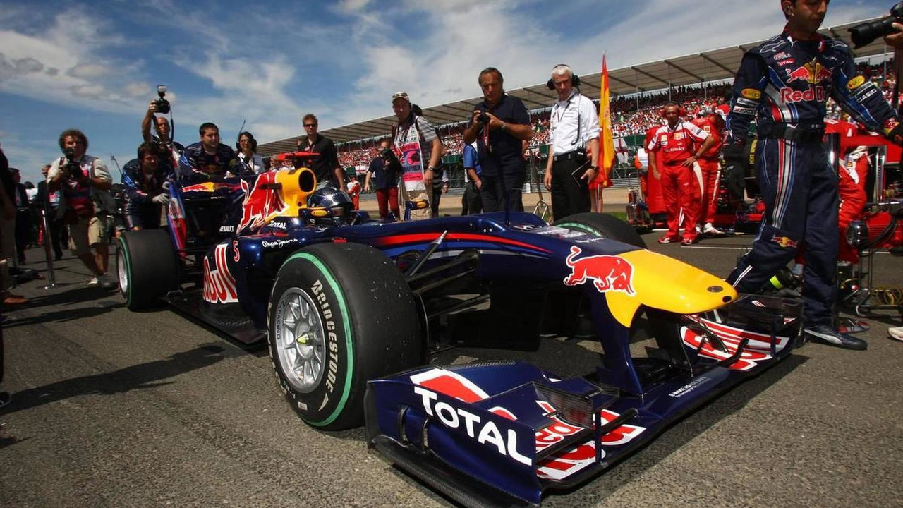 Sebastian Vettel's Red Bulll car exibits the new front wing on the Silverstone grid