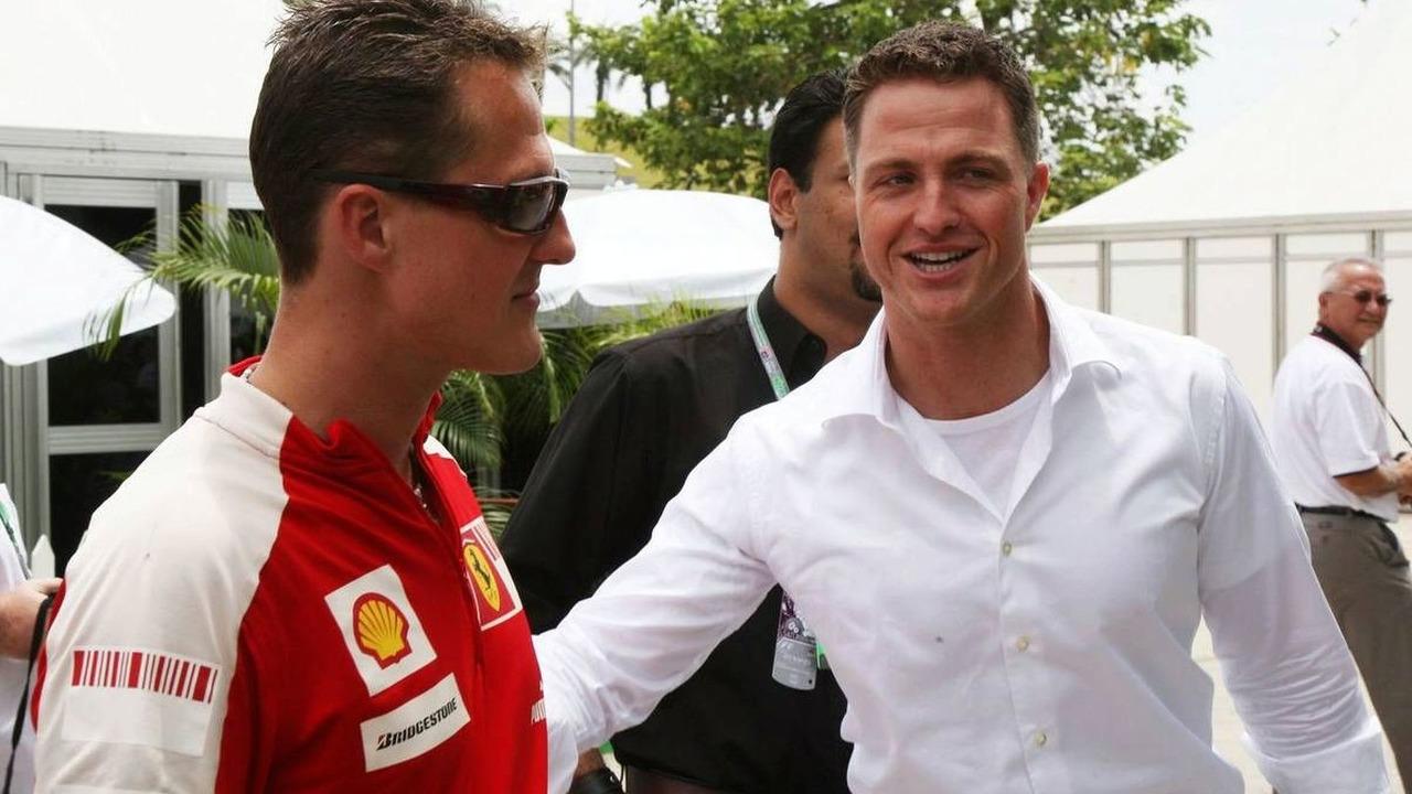 Michael Schumacher and Ralf Schumacher (right)