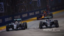 Nico Rosberg, Mercedes AMG F1 W06 passes team mate Lewis Hamilton, Mercedes AMG F1 W06