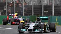 Nico Rosberg (GER) Mercedes AMG F1 W05 leads Daniel Ricciardo (AUS) Red Bull Racing RB10, 2014 Australian Grand Prix