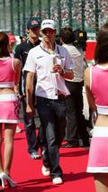 Jenson Button (GBR) walking through Grid girls, Japanese Grand Prix, Suzuka, Japan, 04.10.2009