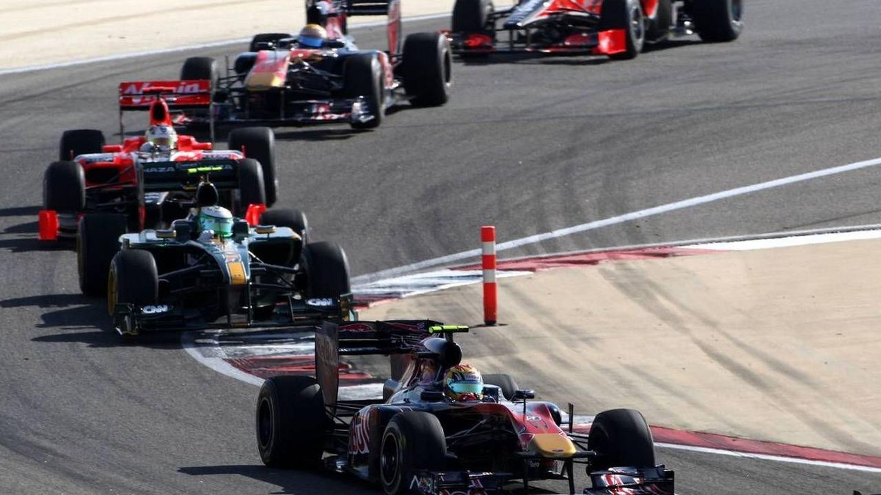Jaime Alguersuari (ESP) leads Heikki Kovalainen (FIN), Bahrain Grand Prix, 14.03.2010 Sakhir, Bahrain